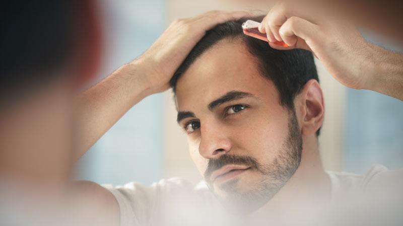 Applicazione lozione per capelli Foltina